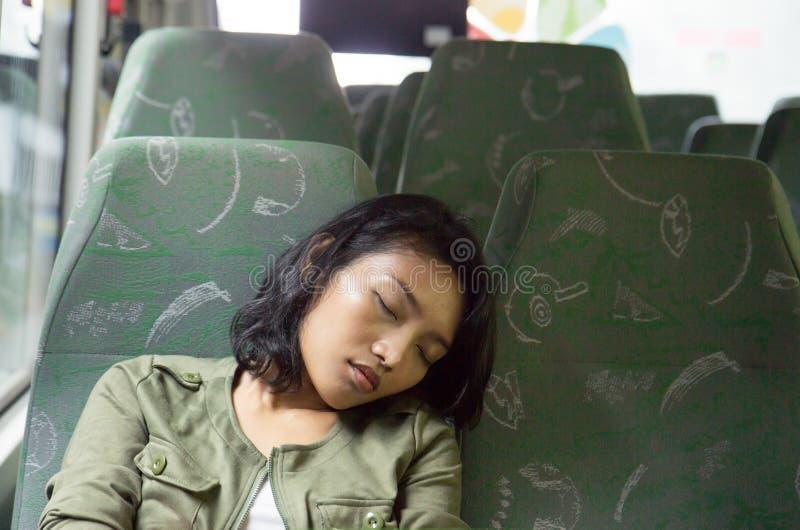 Woman sleeping in the bus stock photos