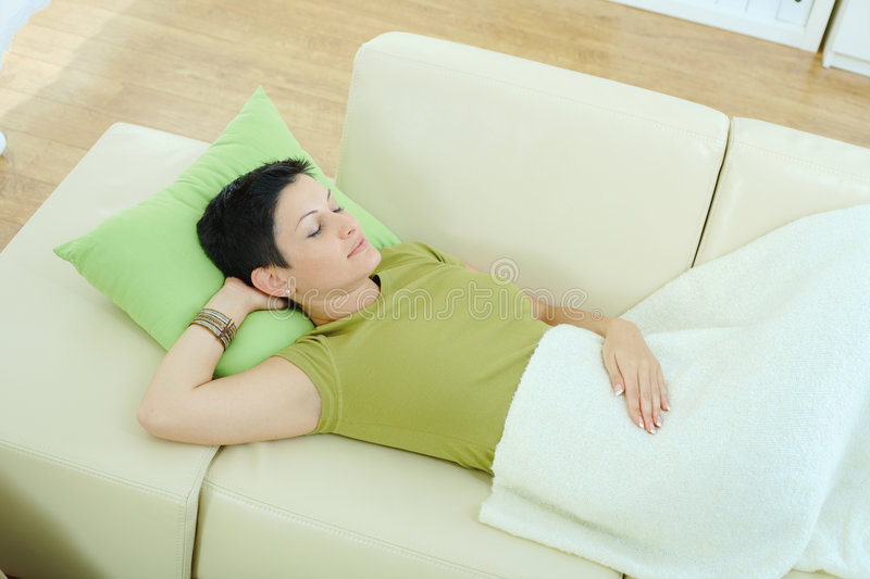 Woman sleeping on couch. At home royalty free stock images