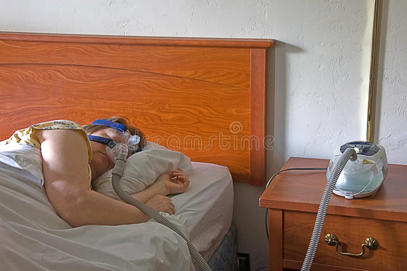Download Woman Sleeping With A CPAP Machine Stock Photo - Image: 9763706