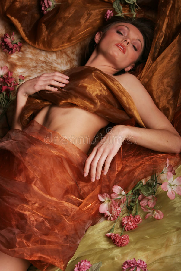 Woman sleeping with flowers royalty free stock photography