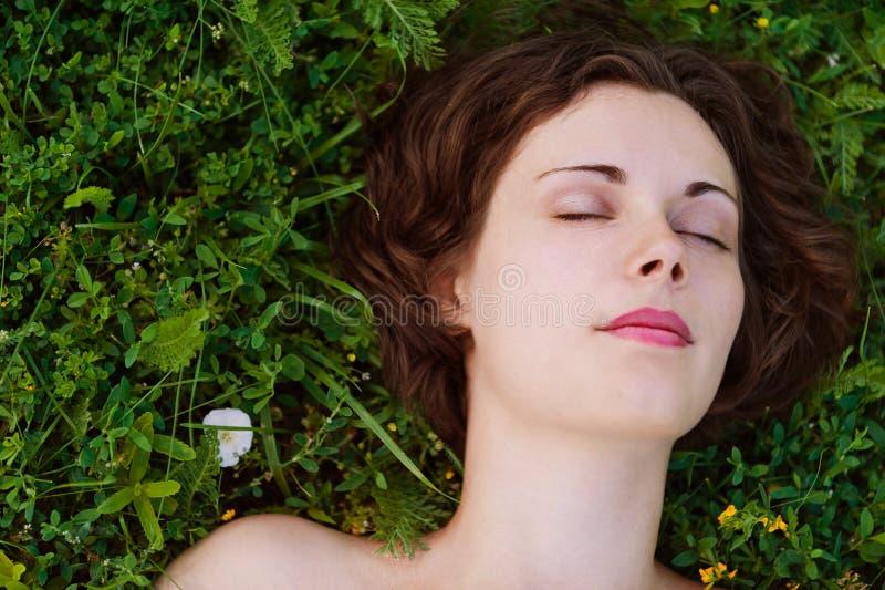Woman Sleeping On Grass Royalty Free Stock Image