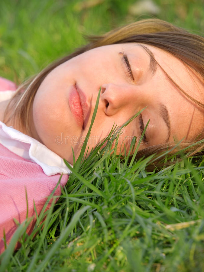 Woman sleeping on the grass royalty free stock image