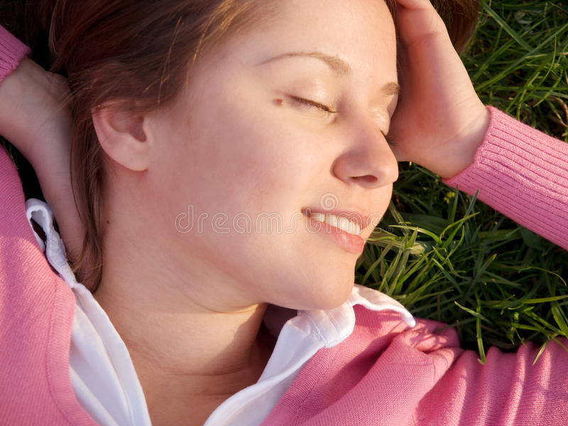 Woman sleeping on the grass royalty free stock photography