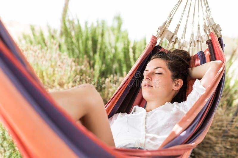 Woman sleeping on hammock royalty free stock images