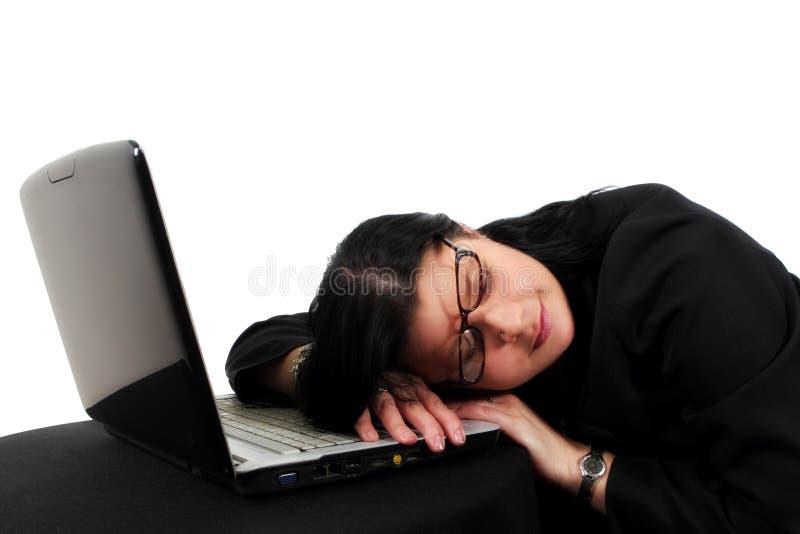 Woman sleeping on keyboard royalty free stock photos