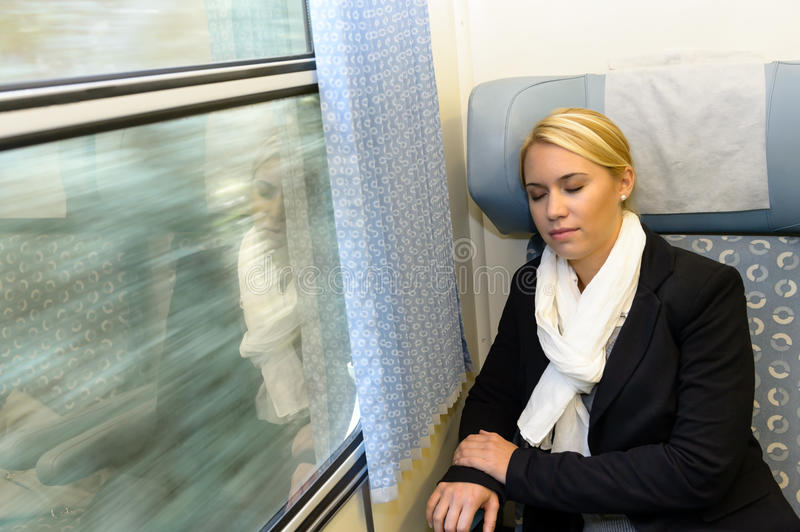 Woman Sleeping In Train Compartment Tired Resting Royalty Free Stock Images