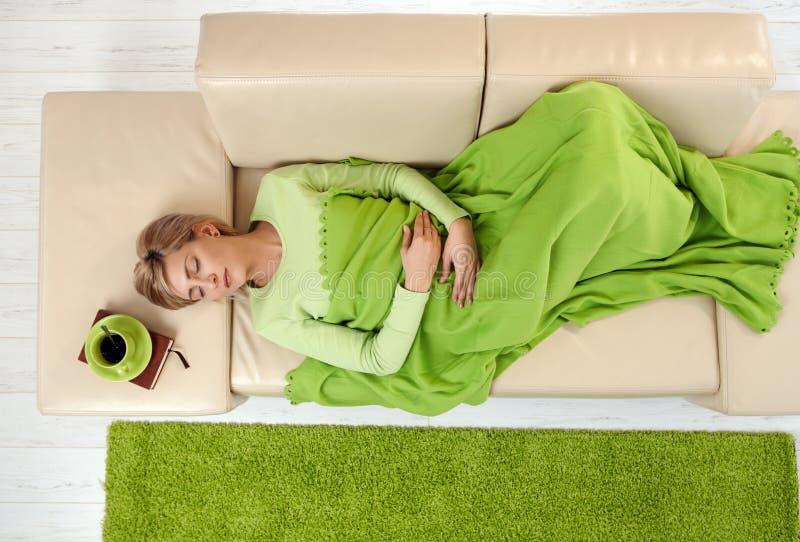 Download Woman Sleeping Under Blanket Stock Photo - Image of hand, eyes: 41198356