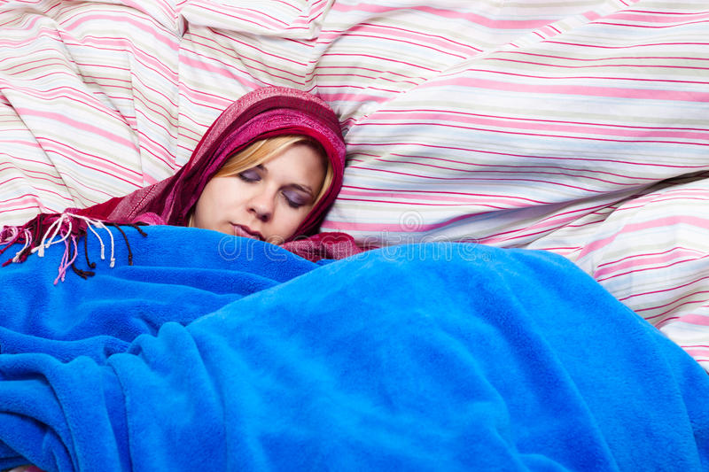 Woman Sleeping Wrapped In Duvet Royalty Free Stock Photo