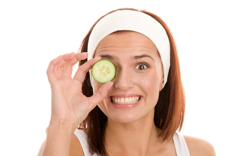 Woman with slice of cucumber royalty free stock photos