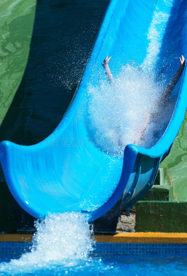 Woman sliding down on water-slide. royalty free stock photos