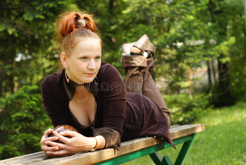 Woman on small bench stock photos