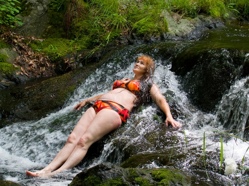 Download Woman on small waterfall 2 stock image. Image of people - 12900433