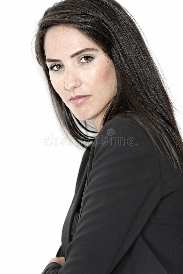 Woman in smart business suit. Professional working woman in corporate business clothes with a serious look royalty free stock images