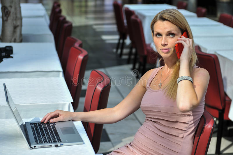 Woman Smart Phone And Laptop Royalty Free Stock Images