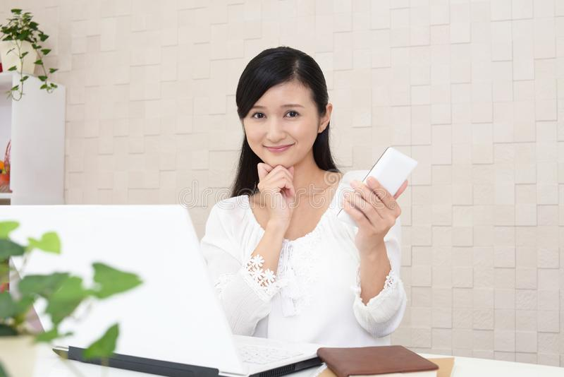 Woman with a smart phone stock photo