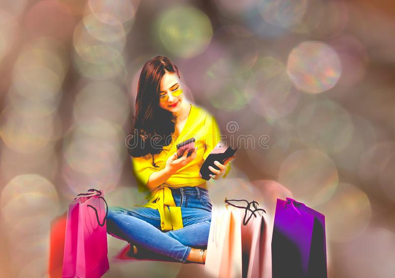 Woman with smartphone & credit card swiping machine. shopping lifestyle & payment with nfc technology. Woman with smartphone & credit card swiping machine royalty free stock photography