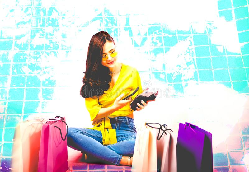 Woman with smartphone & credit card swiping machine. shopping lifestyle & payment with nfc technology. Woman with smartphone & credit card swiping machine royalty free stock image