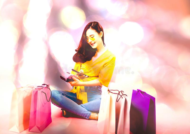 Woman with smartphone & credit card swiping machine. shopping lifestyle & payment with nfc technology. Woman with smartphone & credit card swiping machine royalty free stock photos