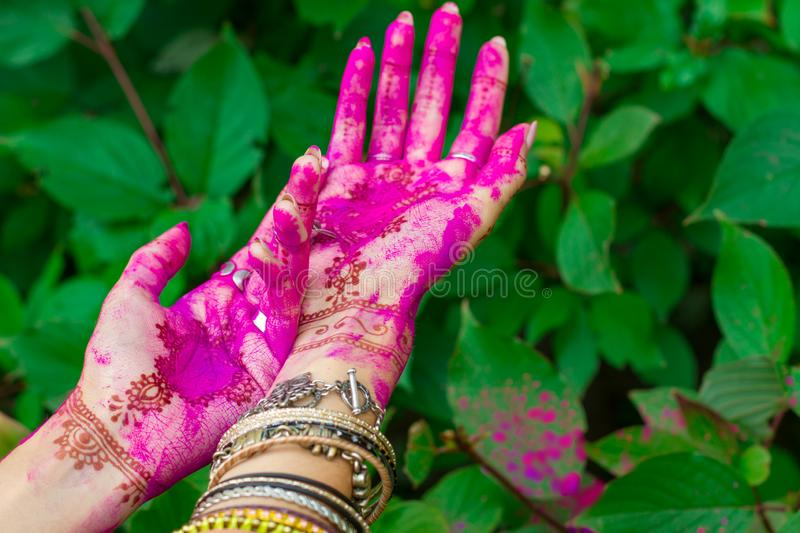 Indian hands with mehendi draws and bracelets royalty free stock photos