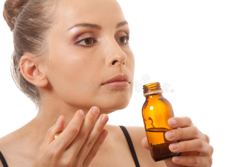 Woman smelling bottle royalty free stock image