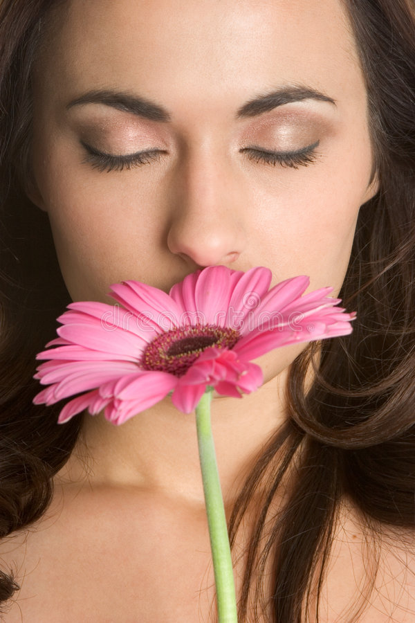 Woman Smelling Flower royalty free stock photos