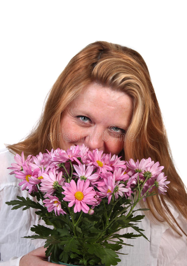 Woman smelling flowers royalty free stock photography