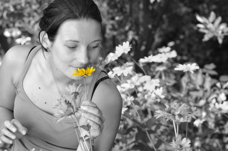 Download Woman Smelling Flowers. Stock Image - Image: 22574591