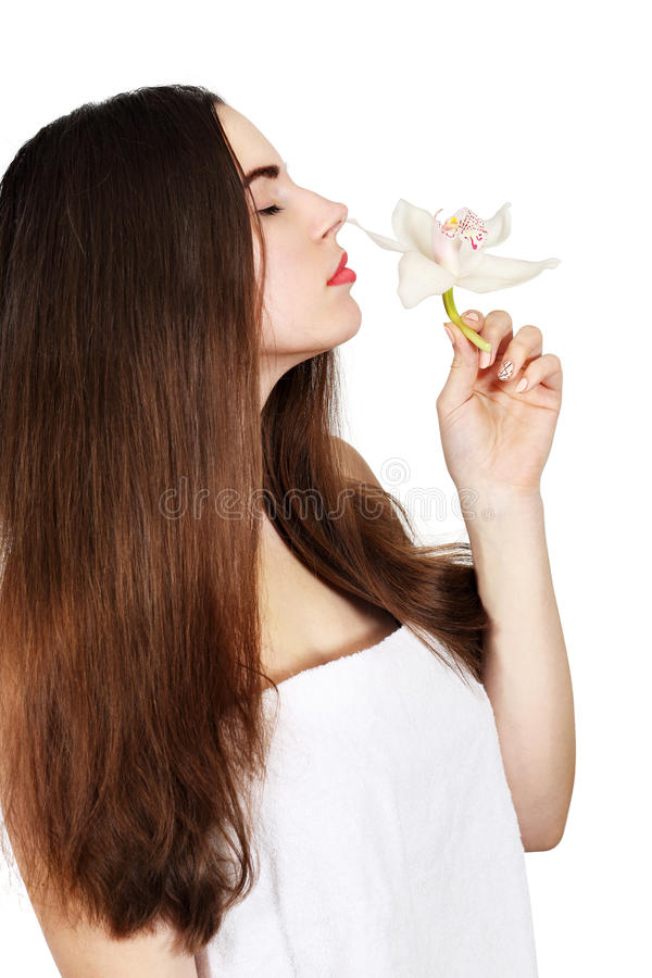 The woman is smelling orchid stock images