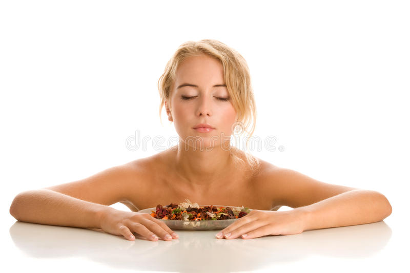 Woman smelling potpourri stock photography