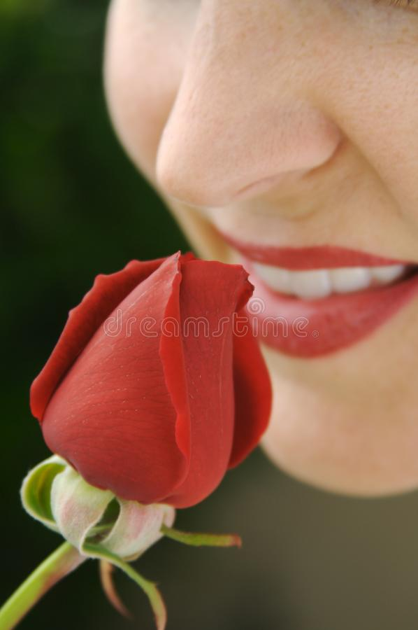 Woman Smelling Rose Bud stock image