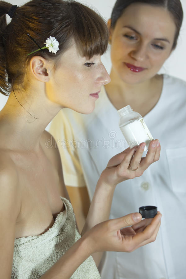 Woman Smells Cosmetic Product Stock Photo