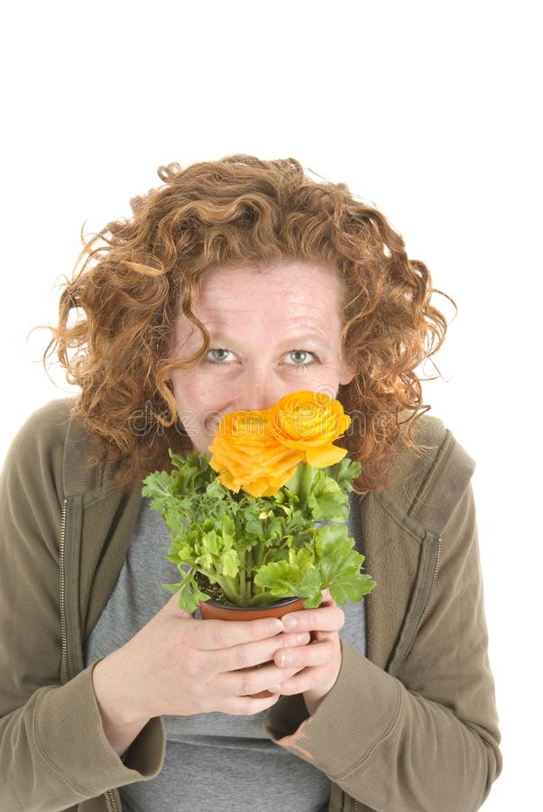 Woman  smells yellow plant royalty free stock images