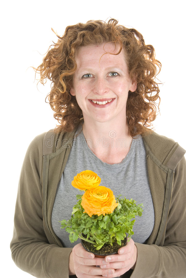 Free Woman Smells Yellow Plant Royalty Free Stock Photography - 8966117