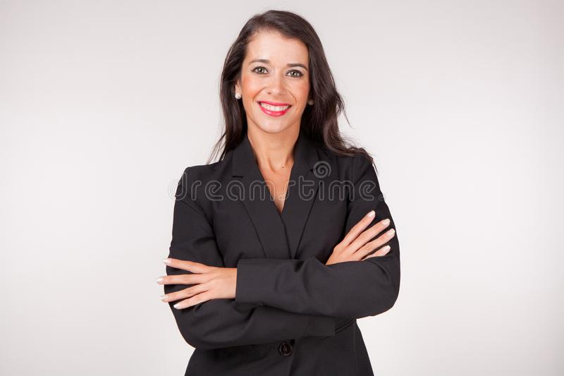 Woman with a smile and arms crossed stock image