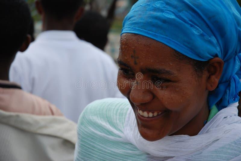 Addis Ababa, Ethiopia: Woman smiling after being baptised during Epiphany royalty free stock photo