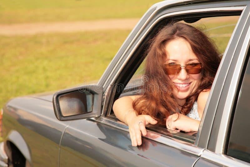 Download Woman Smiles In A Car Window Stock Photo - Image of looking, door: 8146990