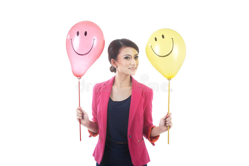 Woman With Smiley Face Balloon Stock Photography