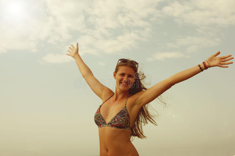 Woman smiling arms raised up to blue sky, celebrating freedom. Positive human emotions, face expression feeling life perception su. Ccess, peace of mind concept royalty free stock images