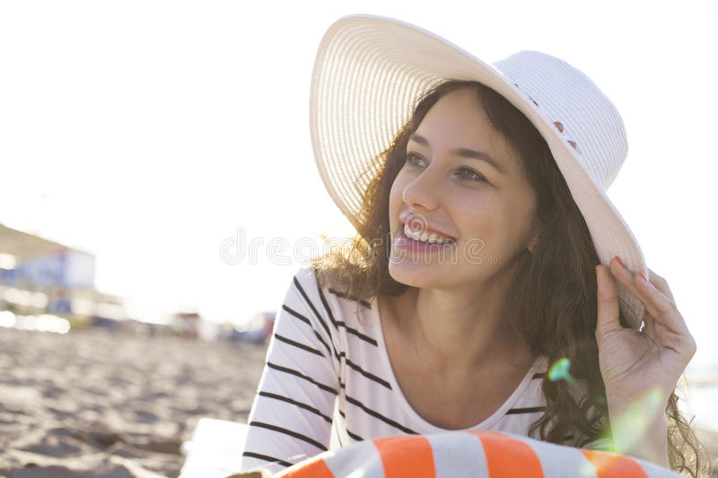 Woman smiling at beach royalty free stock photography