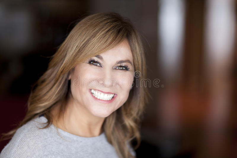 Woman smiling at the camera at home. Indian culture royalty free stock photography