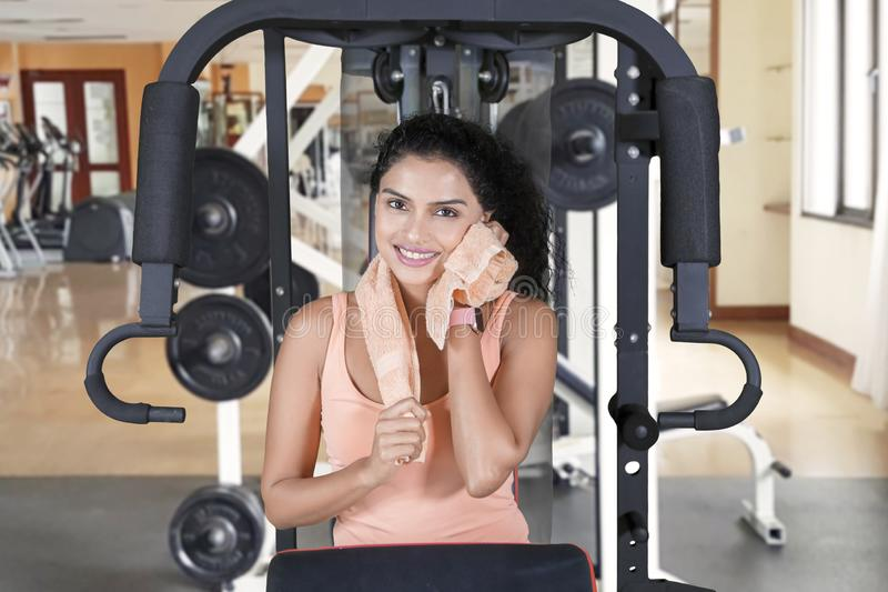 Woman smiling at camera while wiping sweat stock images
