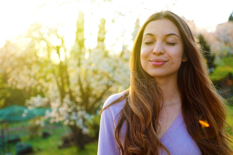 Woman smiling with closed eyes taking deep breath celebrating freedom. Positive human emotion face expression feeling life. Perception success peace mind royalty free stock photography