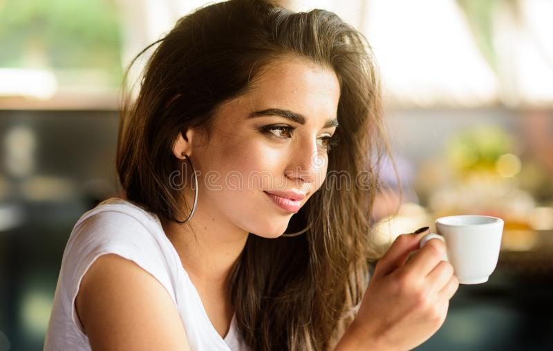 Woman smiling face make up holds coffee cup. Girl enjoy aromatic coffee drink. Girl attractive gorgeous brunette middle. Eastern appearance drinks coffee close royalty free stock image