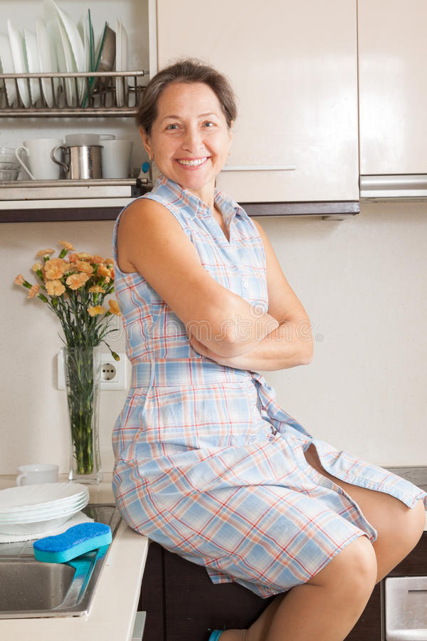 Woman Smiling At Her Big Kitchen Stock Photo - Image 48785402-3443