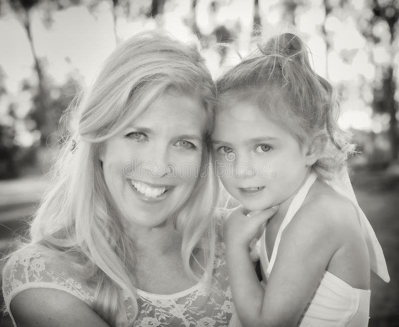 Woman Smiling with her Daughter royalty free stock image