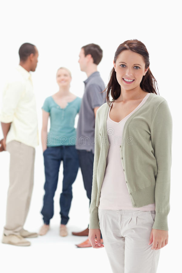 Download Woman Smiling With Her Friends Chatting Behind Stock Image - Image of women, standing: 23012805