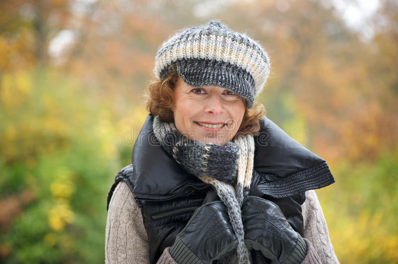 Download Woman Smiling in the Park stock image. Image of gloves - 28713029