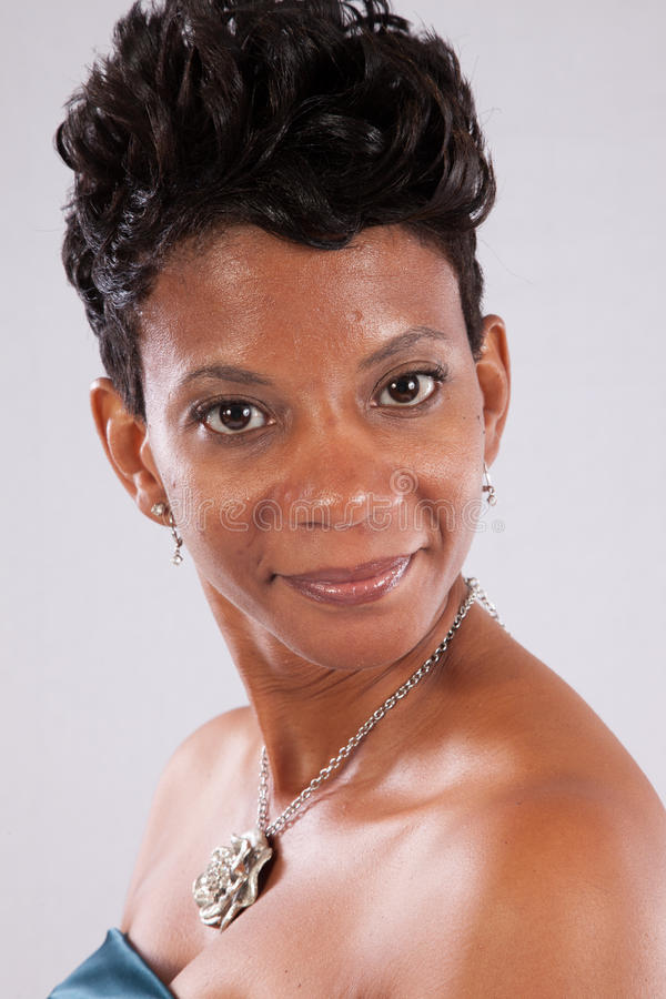 Woman smiling. Pretty black woman with happy attitude royalty free stock image