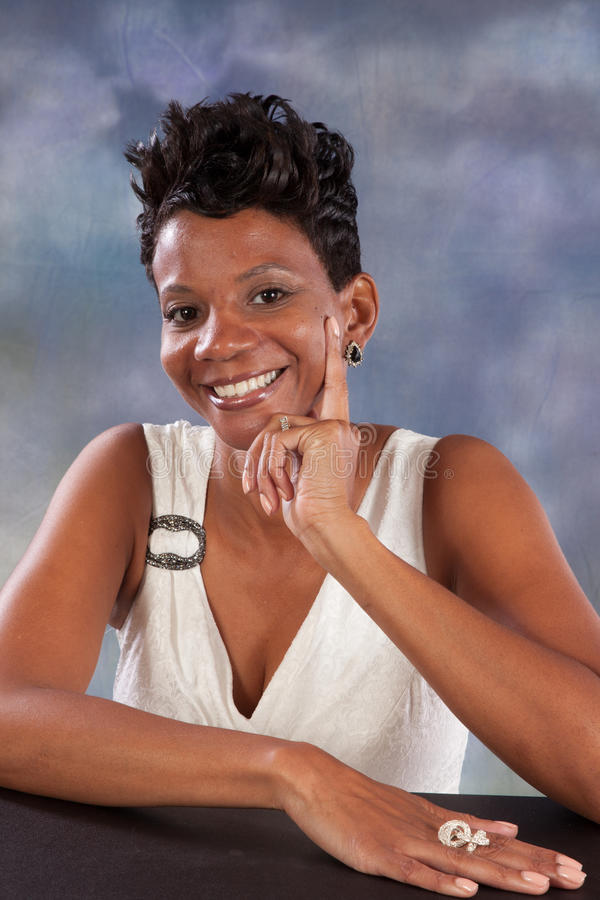 Woman smiling. Pretty black woman with happy attitude royalty free stock photography