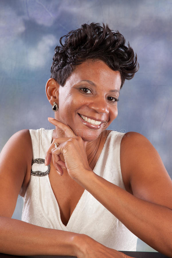 Woman smiling. Pretty black woman with happy attitude stock photography